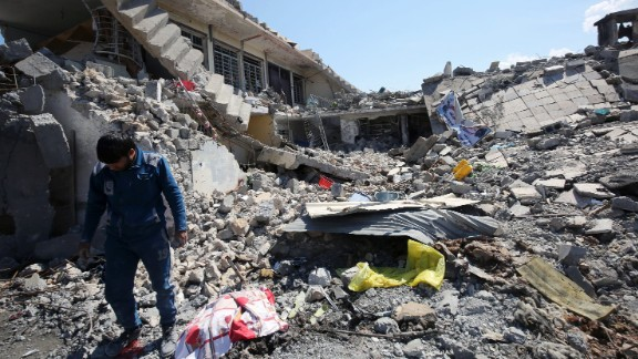 An Iraqi man inspects the damage in the Mosul al-Jadida area on March 26, 2017, following air strikes in which civilians have been reportedly killed during an ongoing offensive against the Islamic State group. Iraq is investigating air strikes in west Mosul that reportedly killed large numbers of civilians in recent days, a military spokesman said.