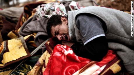 A man breaks down in tears after a deadly airstrike in Mosul on March 17.