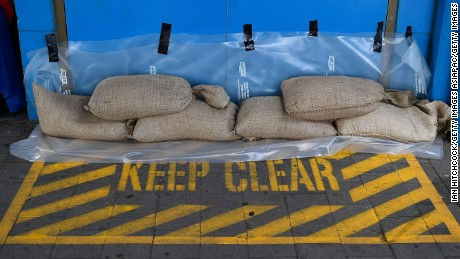TOWNSVILLE, AUSTRALIA - MARCH 27:  Seen are sandbags placed next to a doorway at the Magnetic Island ferry terminal  for protection in preparation for Cyclone Debbie  on March 27, 2017 in Townsville, Australia. Cyclone Debbie intensified to a category 3 system this morning and is expected to make landfall near Bowen, QLD as a category 4 system tomorrow morning.  (Photo by Ian Hitchcock/Getty Images)
