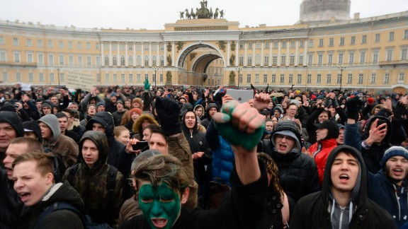 Opposition supporters participate in an anti-corruption rally in central Saint Petersburg on March 26, 2017. Thousands of Russians demonstrated across the country on March 26 to protest at corruption, defying bans on rallies which were called by prominent Kremlin critic Alexei Navalny -- who was arrested along with scores of others. Navalny called for the protests after publishing a detailed report this month accusing Prime Minister Dmitry Medvedev of controlling a property empire through a shadowy network of non-profit organisations.   / AFP PHOTO / Olga MALTSEVA        (Photo credit should read OLGA MALTSEVA/AFP/Getty Images)