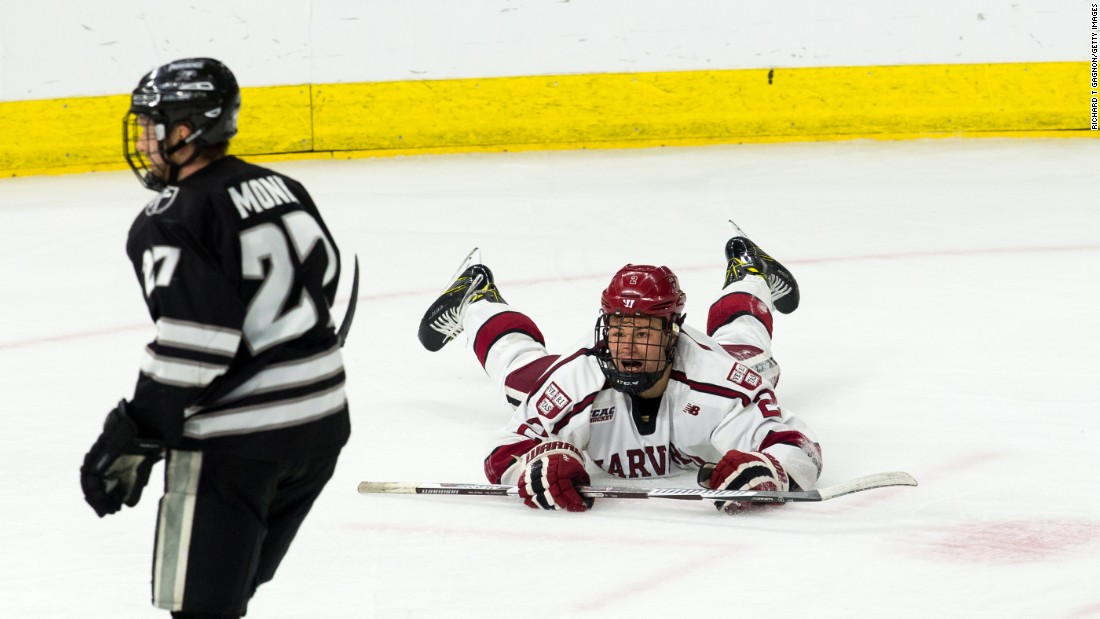 Tyler Moy of the Harvard Crimson celebrates his second goal against the Providence College Friars during the NCAA Division I men's ice hockey East Regional Championship semifinal on Friday, March 24, in Providence, Rhode Island. The Crimson won 3-0.
