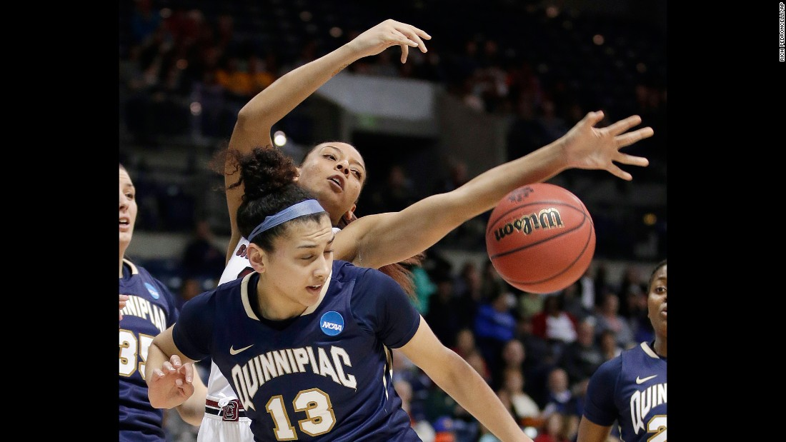Quinnipiac forward Sarah Shewan and South Carolina's Mikiah Herbert Harrigan compete for the ball during a regional semifinal game in the NCAA Tournament  on Saturday, March 25. South Carolina thumped Quinnipiac 100-58.