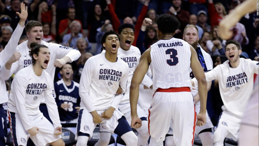 Gonzaga forward Johnathan Williams celebrates after dunking against Xavier during the second half of an NCAA Tournament regional final game on Saturday, March 25. The team advanced to their first Final Four.