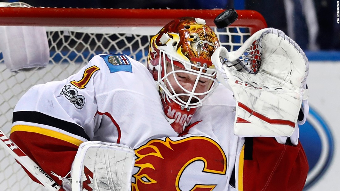 Calgary Flames goalie Brian Elliott braces as a puck sails overhead during the second period of an NHL game against the St. Louis Blues, on Saturday, March 25.