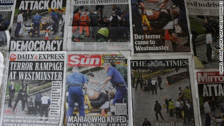 An arrangement of newspapers pictured in London on March 23, 2017, as an illustration, shows the front pages of the UK daily newspapers reporting on the March 22 terror attack that claimed at least three lives in Westminster central London.   Britain's parliament reopened on Thursday with a minute's silence in a gesture of defiance a day after an attacker sowed terror in the heart of Westminster, killing three people before being shot dead. Sombre-looking lawmakers in a packed House of Commons chamber bowed their heads and police officers also marked the silence standing outside the headquarters of London's Metropolitan Police nearby.  / AFP PHOTO / DANIEL SORABJI        (Photo credit should read DANIEL SORABJI/AFP/Getty Images)