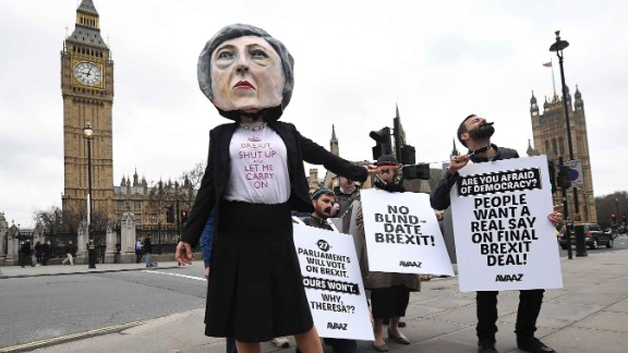 Protesters outside Parliament in London criticize Prime Minister Theresa May