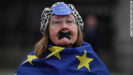 A pro-EU supporter draped in an EU flag near the Houses of Parliament in London on March 29, 2017.