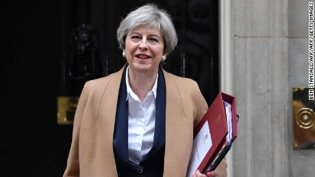 British Prime Minister Theresa May leaves 10 Downing Street before heading to the Houses of Parliament to attend the weekly Prime Minister's Questions (PMQs) in central London on March 29, 2017.
