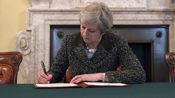 UK Prime Minister Theresa May signs the official letter invoking Article 50 on March 29.