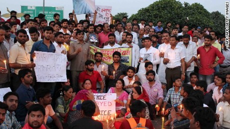 People gather for a vigil for a teenage boy who died of a suspected drug overdose in Greater Noida, which later turned into a violent rampage against African nationals.
