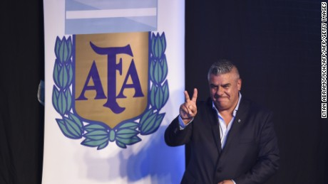The president of Argentinian football team Barracas Central, Claudio Tapia, flashes the V-sign after being elected President of Argentina's Football Association (AFA) in Ezeiza, Buenos Aires on March 29, 2017. / AFP PHOTO / EITAN ABRAMOVICH        (Photo credit should read EITAN ABRAMOVICH/AFP/Getty Images)