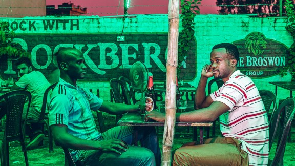 """So far he has been """"overwhelmed"""" by the response. """"My African friends see this work as giving them a voice,"""" he said.    Pictured: Yvanne and his friend at Jimmy's Chicken in Jalandhar,2016"""