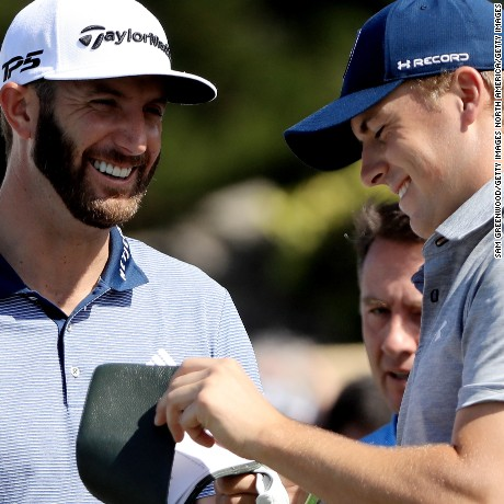 Jordan Spieth and Dustin Johnson talk on the first tee during the first round of the SBS Tournament of Champions at the Plantation Course at Kapalua Golf Club