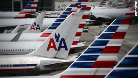 A woman is suing American Airlines over harassing text messages she says she received from an airline employee.