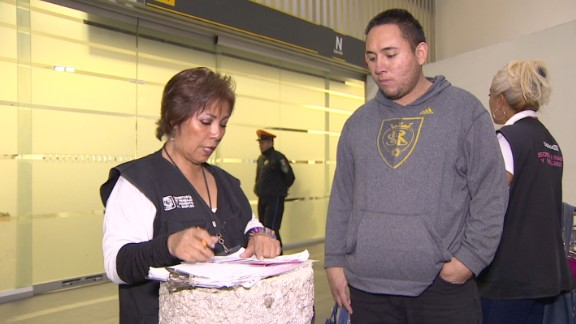 Social worker Celia Anaya tells David Padilla, a deportee who's just arrived from the United States, about government unemployment benefits in Mexico.
