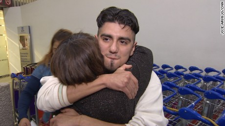 Family members rush to hug Eduardo Hernandez after he arrives in Mexico City on a deportation flight.