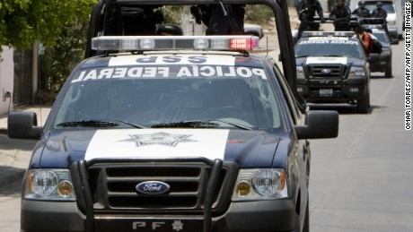 Members of the Mexican Federal Police arrive to patrol the city of Culiacan to reinforce the surveillance operation against drug trafficking in Sinaloa state, north of Mexico on May 28, 2008. The new forces were sent to Sinaloa state a day after a shoot-out between the Federal Police and alleged drug dealers left seven officers killed. AFP PHOTO/Omar Torres (Photo credit should read OMAR TORRES/AFP/Getty Images)