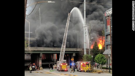 Firefighters battle the fire that eventually led to the collapse of part of Interstate 85.