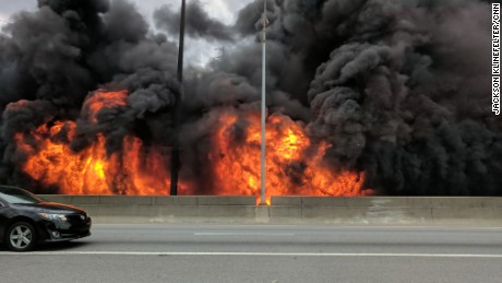 Flames from a massive fire that eventaully led a portion of the highway to collapse, are seen along Interstate 85 in Atlanta on Thursday, March 30.