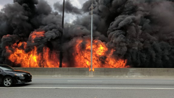 Flames from a massive fire that eventually led a portion of the highway to collapse are seen Thursday along Interstate 85 in Atlanta.