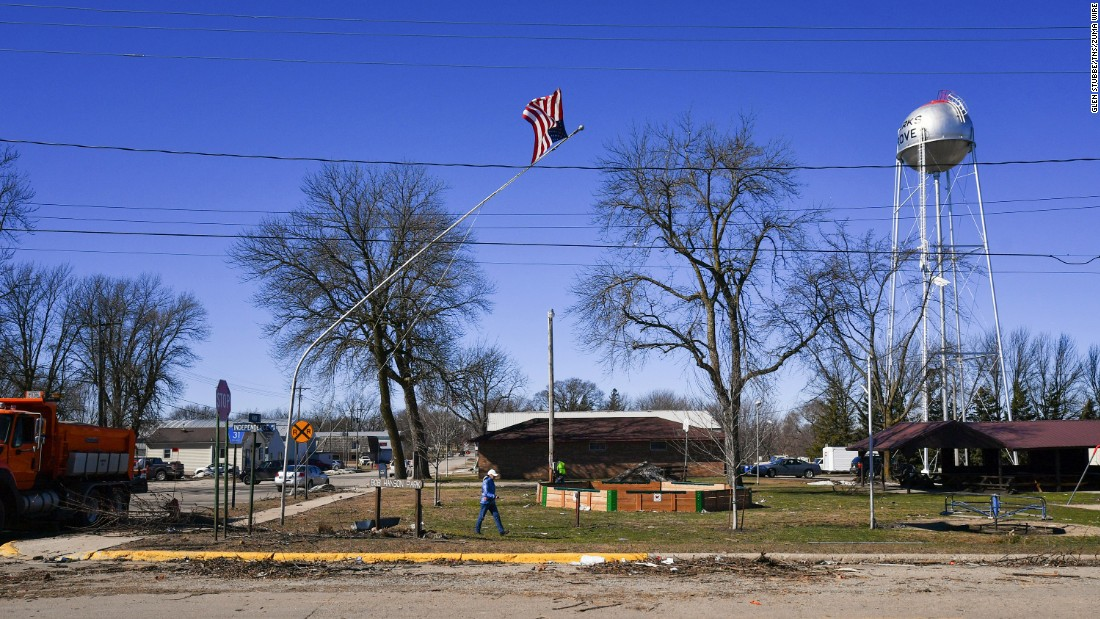A flagpole is bent Tuesday, March 7, following a tornado in Clarks Grove, Minnesota.