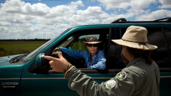 Before heading to her next hunting spot, Donna Kalil, center, chats with fellow python hunter Tom Rahill near Everglades National Park on Thursday, March 30, 2017.Photo by Scott McIntyre for CNN