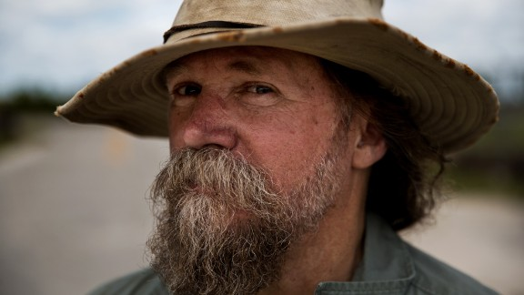 Tom Rahill, founder of the Swamp Apes veterans support group, takes a break during the hunt.