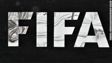 The logo of the International Federation of Association Football (FIFA) is pictured during snowfall, at the FIFA headquarters in Zurich, during meeting of the FIFA's governing council on January 10, 2017. FIFA's ruling council on January 10, 2017 unanimously approved an expansion of the World Cup to 48 teams in 2026, with a format of 16 groups of three nations.  / AFP / Michael Buholzer        (Photo credit should read MICHAEL BUHOLZER/AFP/Getty Images)
