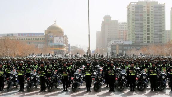 This photo taken on February 27, 2017 shows Chinese police attending an anti-terrorist oath-taking rally in Hetian, in China's Xinjiang region.