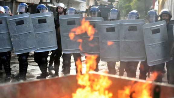 Riot police line up Friday in a crackdown on anti-government protesters in Paraguay's capital.