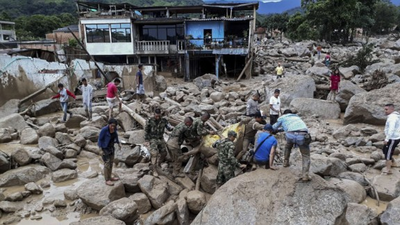 Soldiers recover a body Saturday following mudslides in Mocoa, Colombia.
