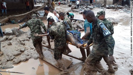 A handout photo made available by the Colombian Army shows soldier evacuating a victim after a landslide in Mocoa, province of Putumayo, Colombia, 01 April 2017.
