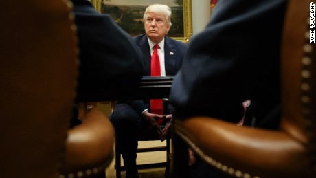 President Donald Trump listens during a meeting with the National Association of Manufacturers, Friday, March 31, 2017, in the Roosevelt Room of the White House in Washington.