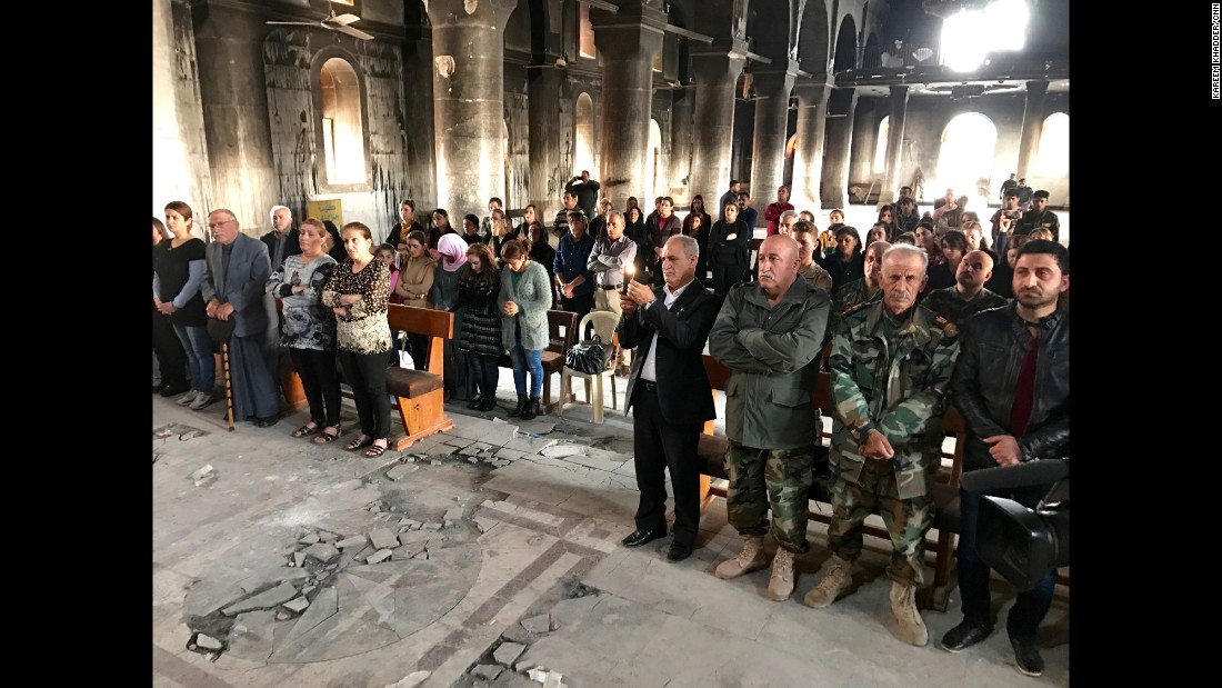 Christian residents of Qaraqosh, near Mosul, return for mass at the Church of the Immaculate Conception after the city was liberated from ISIS in October 2016. Many churches, houses and shops were destroyed and looted by ISIS during the terror group's two-and-a-half year occupation. Qaraqosh was the the largest predominately Christian city in Iraq.