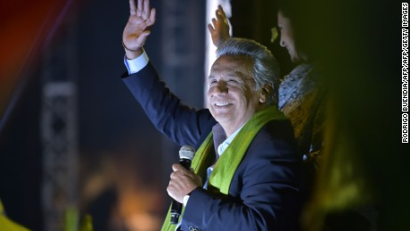 The Ecuadorean presidential candidate of the ruling Alianza PAIS party, Lenin Moreno, waves as his supporters celebrate the initial results of the runoff election, in Quito on April 2, 2017. / AFP PHOTO / RODRIGO BUENDIA        (Photo credit should read RODRIGO BUENDIA/AFP/Getty Images)