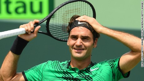 Roger Federer celebrates match point after defeating Rafael Nadal at the Miami Open.