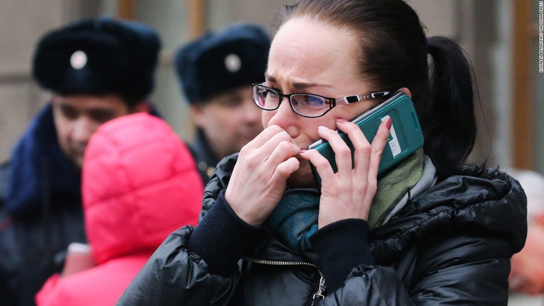 A woman makes a phone call at the entrance to the Tekhnologichesky Institut station.