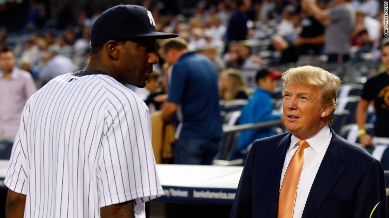 Amar'e Stoudemire of the New York Knicks talks to Donald Trump prior to the game between the New York Yankees and the Tampa Bay Rays on September 23, 2010, at Yankee Stadium.