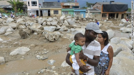 Residents survey damage caused by mudslides, flooding in Mocoa, Colombia.