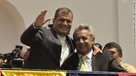 Ecuador's President Rafael Correa (L) and President-elect Lenin Moreno greet supporters from a Carondelet presidential palace balcony, in Quito on April 3, 2017. Socialist Lenin Moreno on Monday celebrated victory in his bid to extend a decade of leftist rule in Ecuador but faced allegations of voting fraud from his conservative rival. Victory for the 64-year-old Moreno, a wheelchair user and political champion of disability rights, would be good news for the Latin American left, which is in decline.  / AFP PHOTO / RODRIGO BUENDIA        (Photo credit should read RODRIGO BUENDIA/AFP/Getty Images)