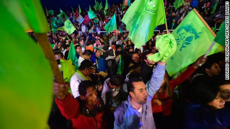 Supporters of Lenin Moreno celebrate after he claims victory in Quito on April 2.