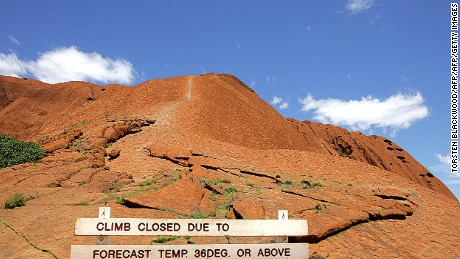 "A sign declares the climb to Uluru ""closed"" in 2005 as desert temperatures soar and high winds make the trek too dangerous."
