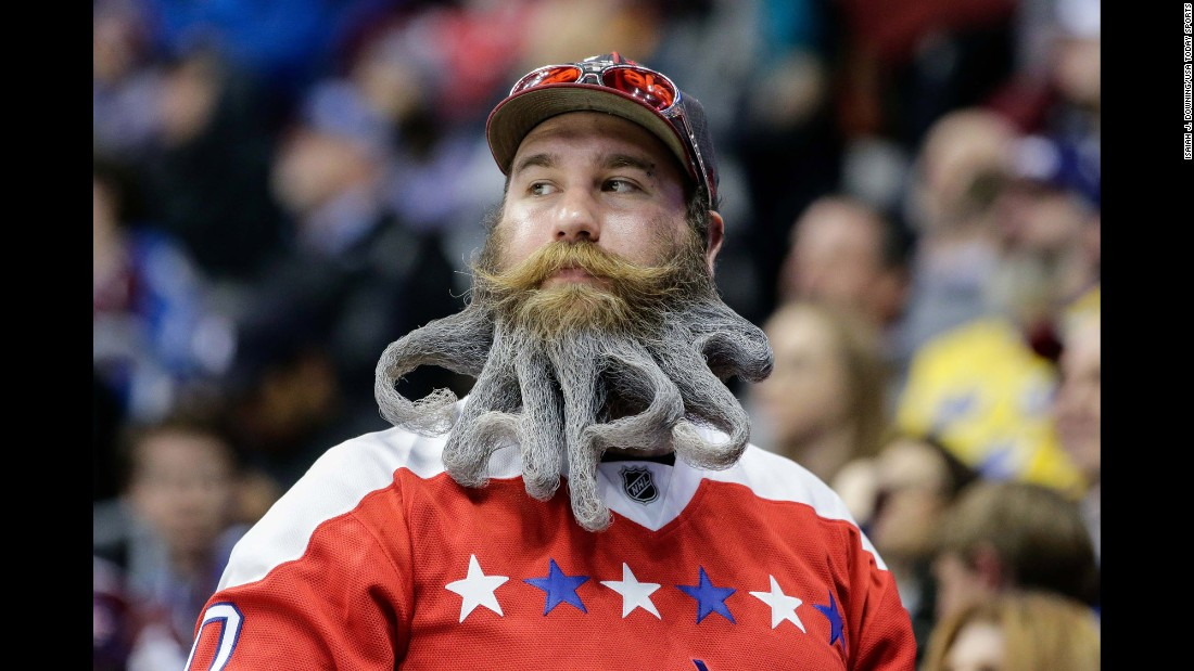 A fan of the NHL's Washington Capitals attends a road game in Denver on Wednesday, March 29.
