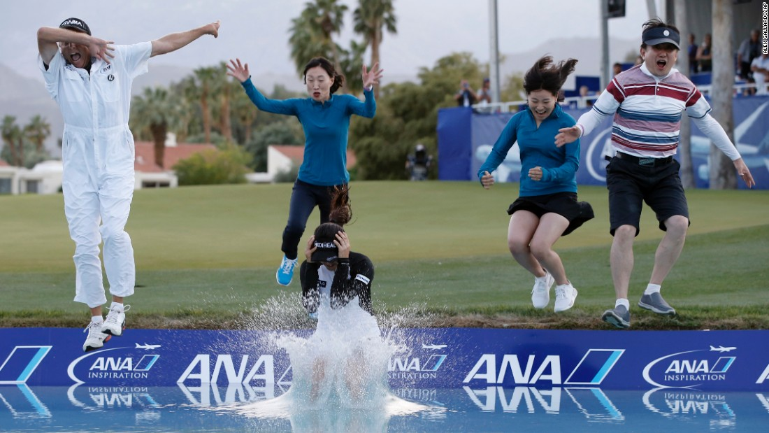 "Golfer So Yeon Ryu, front center, leaps into a pond to celebrate her win at the ANA Inspiration on Sunday, April 2. Ryu was joined, from left, by her caddie, her sister, her mother and a member of her management team. Ryu defeated Lexi Thompson in a playoff after Thompson <a href=""http://www.cnn.com/2017/04/03/golf/tv-viewer-influences-ana-inspiration-lexi-thompson-so-yeon-ryu-four-stroke-penalty/"" target=""_blank"">was given a controversial penalty</a> in the middle of her round."