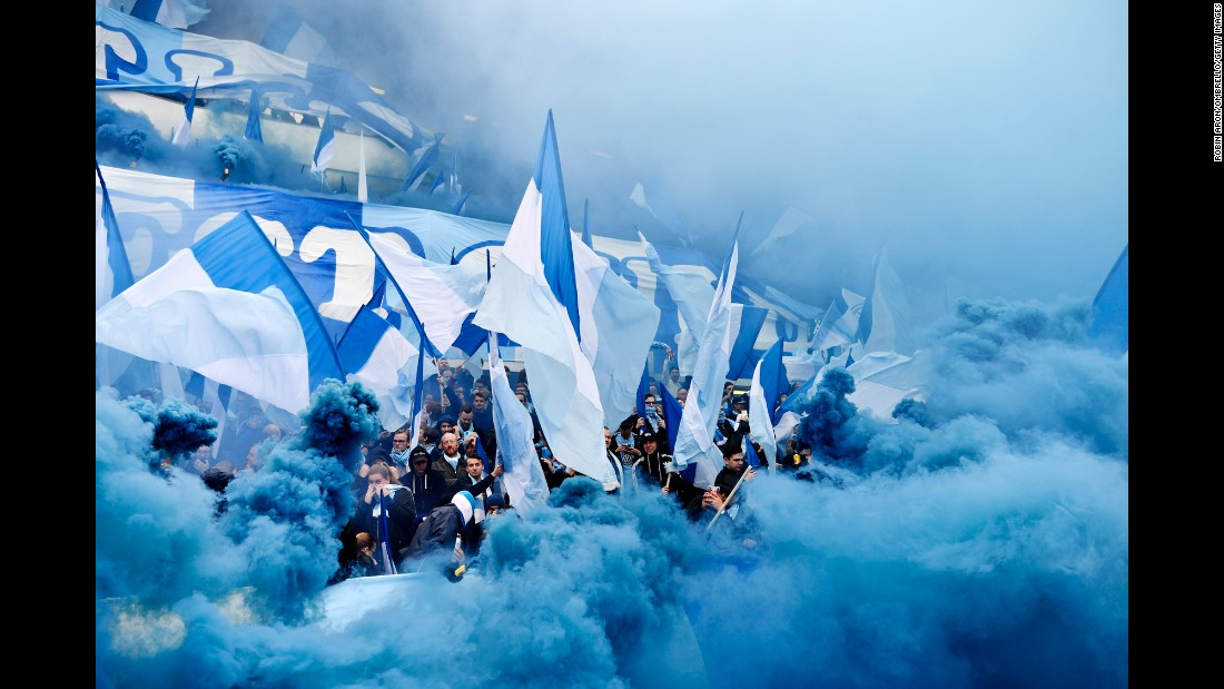 Malmo fans are surrounded by blue smoke during a Swedish league match in Gothenburg on Saturday, April 1.