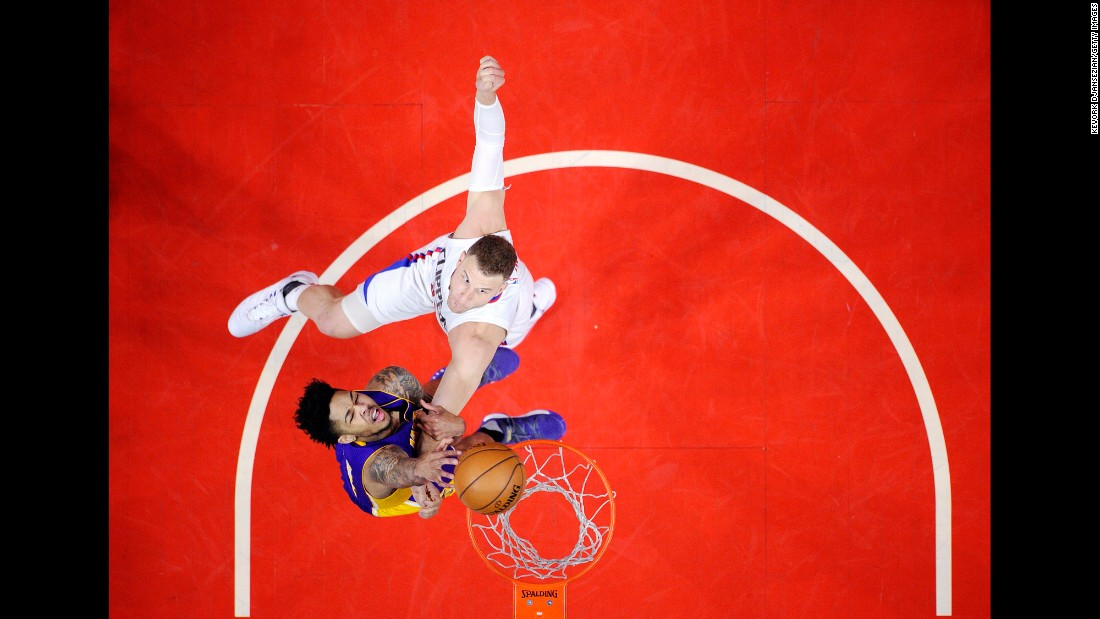 Brandon Ingram, bottom, is fouled by Blake Griffin during an NBA game in Los Angeles on Saturday, April 1. Griffin's Clippers defeated Ingram's Lakers in a game between the city's two teams.
