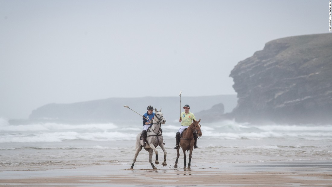 Andy Burgess, left, and Daniel Lowe practice for a beach polo match in Cornwall, England, on Wednesday, March 29.