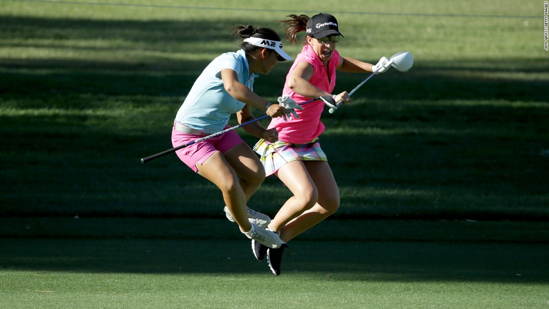 Pro golfer Megan Khang, left, shares a fun moment with amateur Victoria Arlen during a pro-am in Rancho Mirage, California, on Wednesday, March 29.