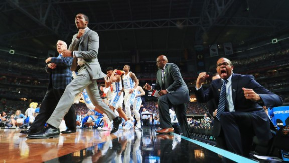 The North Carolina bench reacts to a play in the second half.