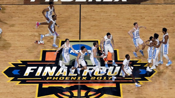 North Carolina players rush the court after the final buzzer. The Tar Heels lost last year